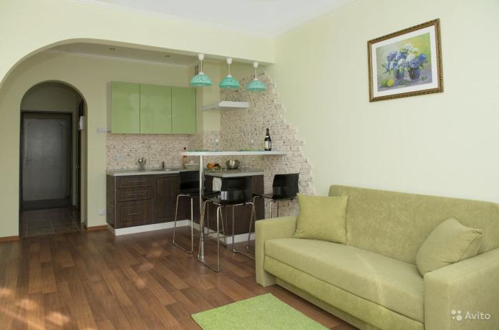 Интерьер квартиры студии в зеленых тонах